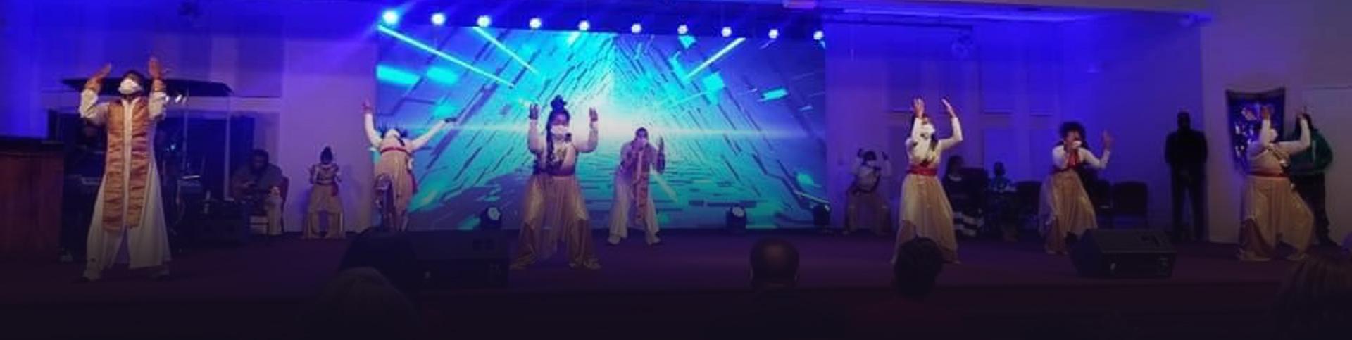 Praise dance team on stage praise dancing